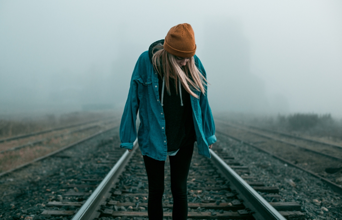 negative-space-woman-raliway-tracks-hat-shirt-rain-elliott-chau